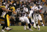 (JPM1006) In the third quarter, Denver Broncos Mike Bell follows the block of Cecil Sapp and turns...