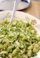 (NYT49) UNDATED -- Nov. 14, 2006 -- THANKSGIVING-GREENS-2 -- Slice brussels sprouts and give them...