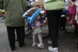 Destiny Simmons,(cq), 4, has her hands full of sweaters selected for her by her aunt, Janice...