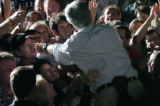 (8/06/2004,Kansas City, MO))  John Kerry is held by secret service agents as he reaches into a...