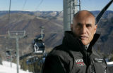 Pat O' Donnell (cq) rides the new gondola to the top of Aspen Mountain in Aspen November 1, 2006....