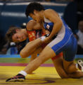 (Athens, Greece  on Monday, Aug. 23, 2004) - Kaori Icho of Japan, right, controls  American silver...