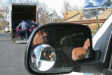 (DLM4138) -  Denver Police Officer Andy Ramirez keeps a watchful eye on Sean Davis and Tony...