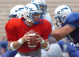 Saturday, August 20, 2004-photo by Jerilee Bennett-Air Force freshman quarterback Shaun Carney...