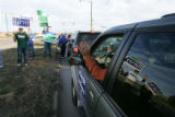 (Timeshot: 07: 42) Reflection of republicans holding up campaign signs for morning rush hour...