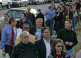 8:46 a.m. Bill Ritter, Democratic candidate for governor holds a cup of coffee as he waits in line...
