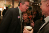 Jay Fawcett, cq, left, a candidate in Colorado's 5th congressional district, greets supporters to...