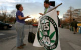 Cindy Lewis, cq of Denver has a corner debate with Mason Tvert, Campaign Director SAFER, marijuana...