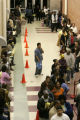 (BG0024} (((SHOT AT 7:17 PM)))) A man step out of line as voters wind up and down hall ways at the...