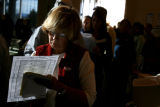 (DLM0332) -  Natalie Roesch checks over her ballot sheet that helps her organize how she is going...