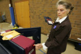 (Timeshot: 06: 33) Election judge and voting machine specialist  Joyce Knutson (cq), left, notices...