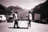 Trey Anastasio and Page McConnell of Phish carrying a keyboard across the street in Telluride for...