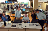 This perspective, looking back into the newsroom shows Interactive Editor Mike Noe, seated center,...