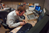 For lack of more sophisticated technology Rocky Mountain News Producer Forrest Stewart sep up a...