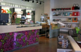 Jennifer Roberts (cq), behind counter,  owner of Composition, a modern life style store, Wednesday...
