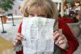 Michele Ienna, (cq), 43, with her seemingly complete shopping list having joined family in an...