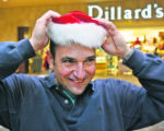 Yannis Konstantopoulos, (cq), 41, Broomfield, Colo., puts on the hat his daughter was wearing to...