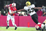 (DLM1147) -  In the third quarter University of Nebraska quarterback Zac Taylor slips past...