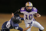 Columbine's  Ben Tedford (#88) tackles Garret Houts, Fort Collins' backup quarterback (the...
