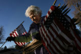MJM009  Geri Tolen (cq), 75, of Denver places a flag near a grave of a veteran Friday morning at...