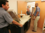 Anthony Rainey, right, the Denver Election Commission's technology chief at the center of...