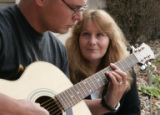 Edith LeMaster(cq) listens to her son Joe Kaniatobe (cq) play his guitar Tuesday afternoon...