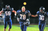 Columbine's (left to right) Travis Duffy (#56), Mitchell Sturm (#78) and Mitch Schubert (#30)...