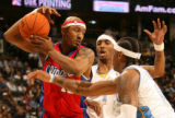 MJM149   James Singleton of the Los Angeles Clippers is defended by J.R. Smith and Carmelo Anthony...