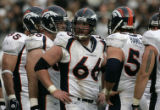(BG0911} Denver Broncos Center Tom Nalen leads the offensive line to a 17-13 victory over the...