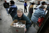 Ardeth Platte, O.P., loads a box of can goods onto a truck along with others at the Denver Rescue...
