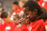 (DLM0876) -  Anne Mwangi, 8, prays along with the other kids in the CedarWood Christian Academy...
