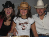 From left, Marcie Buschy, Kerry Gedert and Lasso-man Ty Williams enjoy the Urban Cowboy benefit....