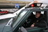 (DLM3454) -  Georgetown Police Chief George Weidler, sits in his jeep at the west bound on-ramp...