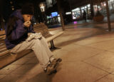 Christopher Perrecone  hunkers down on the  16th Street Mall and eats a bean burrito-like meal...