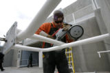 Fidel Aguilar, cq of Skyline Steel, makes repairs to a pedestrian railing, Tuesday Nov. 13, 2006...