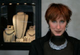 Melissa Oster at her boutique Oster's, poses by an Antonini blue topaz and diamond necklace with...