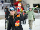 Sara Shainholtz (cq) of Denver hikes with her skis on her shoulder up to wait in  line at the...