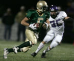 Mountain Vista's Matt Tuten, left, runs with the ball with Douglas County's Michael Facchinello,...