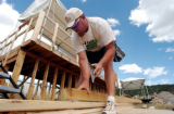 (EAGLE, Colo., Aug. 24, 2004)   Construction worker, Brian Butt of Eagle,  checks out a piece of...