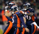 In the second quarter, the Denver Broncos Jay Cutler (#6) is congratulated by teammate Mike Bell...