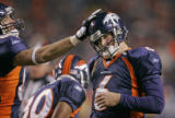 BG372 In the second quarter, the Denver Broncos new starting quarterback Jay Cutler, right, is...