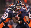 [JPM0182] In the first quarter, the Denver Broncos Jay Cutler (6) hands off to running back Mike...