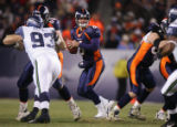 [JPM0003] In the first quarter, the Denver Broncos quarterback Jay Cutler (6) looks to pass...