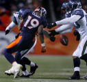 Brian Clark loses the ball on a punt return in the fourth quarter of the Denver Broncos against...