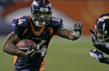 BG0274 In the second quarter, Denver Broncos Javon Walker gets around San Diego Chargers Quintin...