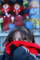 Odelia Cobarruzais, cq, of Lakewood holds her scarf tightly to her face as she waits for the bus...