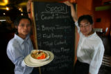 (DLM0263) -   Chef Aung Kyaw, from left, holds a plate of green curry as he stands next to owner...