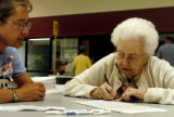 (FORT COLLINS COLORADO - August 10, 2004 )  Sarah Nauta  signs her Provisional Ballot Tuesday...