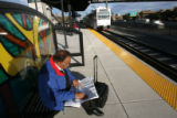 (DLM5932) -  Rajesh Dham, of Englewood, waits at the Orchard Road Station for a F-Line train to...