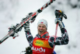 Norway's Aksel Lund Svindal celebrates as he takes the podium after the Slalom run of the Visa...